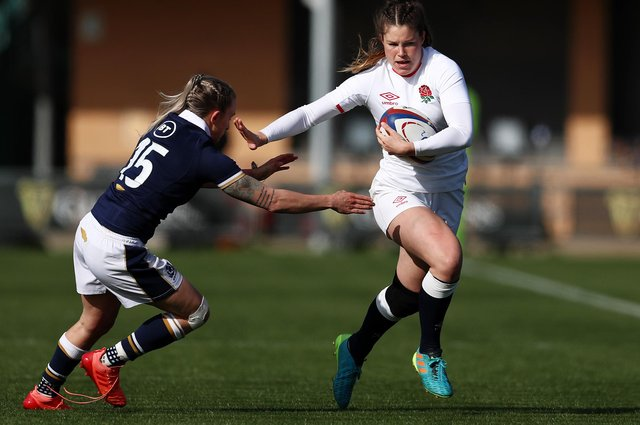Jess Breach holds off Jedburgh's Chloe Rollie during the Women's Six Nations match between England and Scotland at Castle Park on April 3, 2021,  in Doncaster (Photo by Jan Kruger/Getty Images)