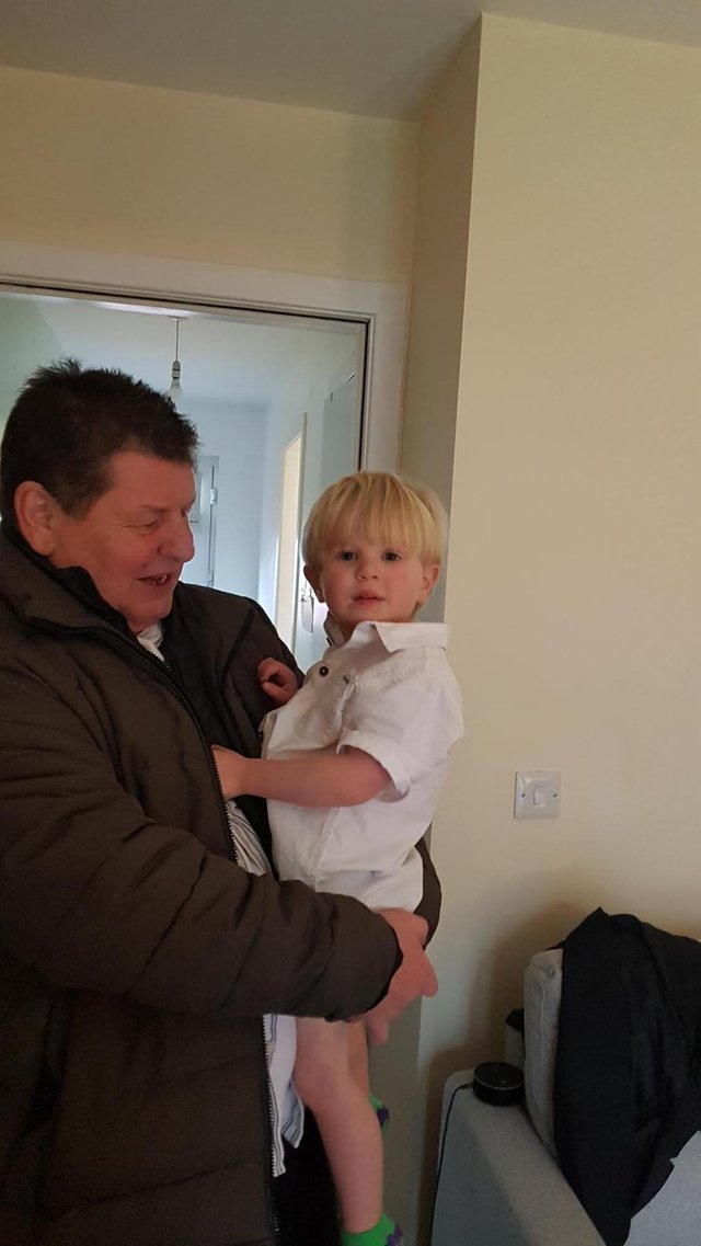 The victim George Gilmour with his grandson Harris.
