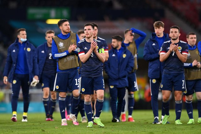 Andy Robertson of Scotland applauds the fans with team-mates following defeat to Croatia on Tuesday night (Pic by Stu Forster/Getty Images)