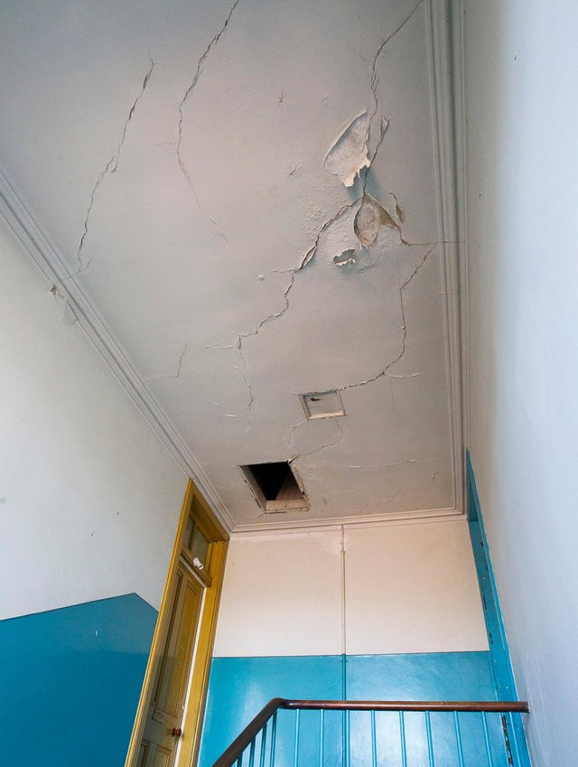 Ceiling damage to communal landing in Beaconsfield Terrace, Hawick. (Photo: Bill McBurnie)