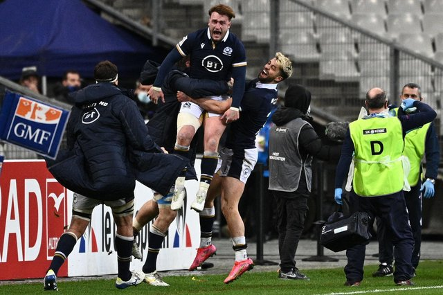 Scotland's Stuart Hogg celebrates with team-mates after beating France at the Stade de France in Saint-Denis, outside Paris. (Photo by Anne-Christine Poujoulat/AFP via Getty Images)