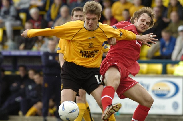 Lee Makel in action for Livingston against Aberdeen. He denies charges which allege he sent abusive texts to his wife.